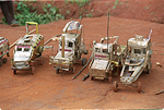 MgM fleet of vehicles out of tin cans.